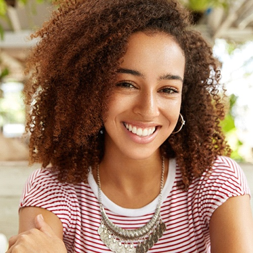 Woman smiling at lunch with white, healthy teeth
